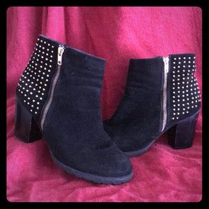 Black heeled booties with gold studs